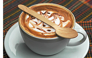 wooden spoon on coffee cup